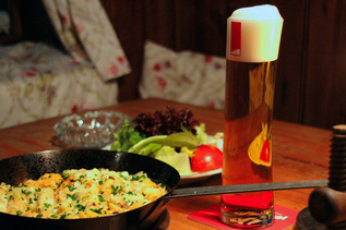 """Kasnocken"" with salad and beer in the Andreas Hofer Weinstube 